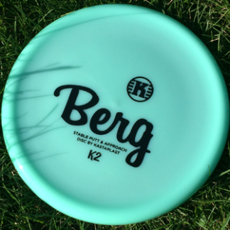 Berg by Kastaplast Mint Green with Black Stamp on Grass