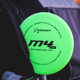 Prodigy Discs M4 Mini in a black disc golf bag.