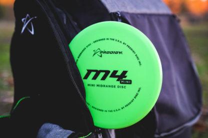 Prodigy Discs M4 Mini in a black disc golf bag.