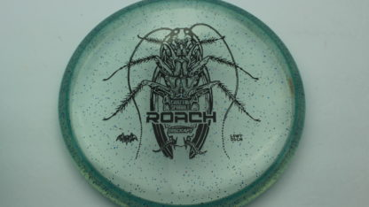Discraft CryZtal Sparkle Roach in blue/green with black Les White design on the stamp.