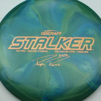 Discraft Titanium Swirl Stalker in green and blue swirls and Paige Pierce Stalker stamp.