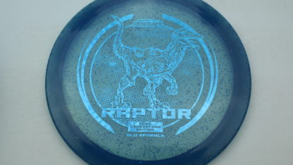 The Discraft Glo Sparkle Raptor in blue plastic with a blue stamp.