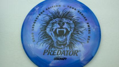 Discraft Swirl ESP Predator with Ledgestone stamp in blue plastic with black stamp.