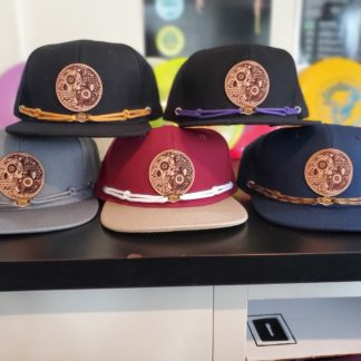 OTB Findlay Hat in all 5 versions on a desk.