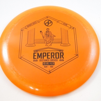 The Infinite Discs Emperor in orange plastic with a black stamp.