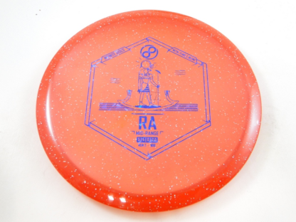 Infinite Discs Ra in red metal flake plastic with purple/blue stamp.