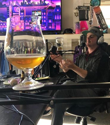 Danny Corbett balancing beer on the disc golf podcast Jammin' With The Best.